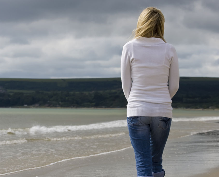 Woman Contemplating on Beach