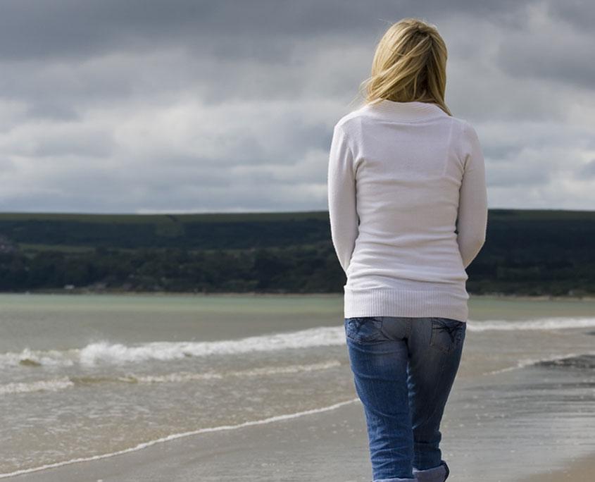 Woman Contemplating on Beach